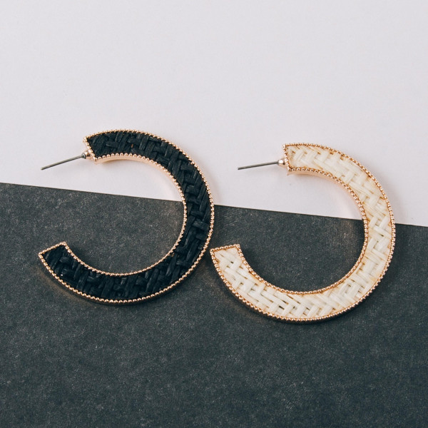 "Open hoop metal earrings featuring rattan inspired detail. Approximately 1.5"" in diameter."