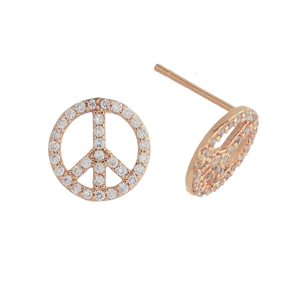 "Dainty rose gold peace sign stud earrings featuring cubic zirconia accents. Approximately .5"" in diameter."