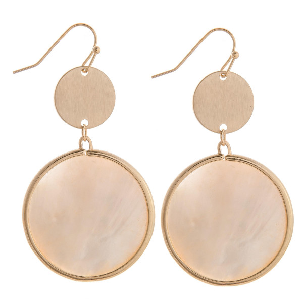 "Long ivory mother of pearl circular earrings with brass detail. Measures approximately 2"" long."