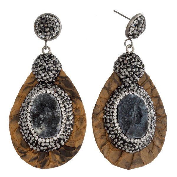 "Long drop earrings featuring faux leather snakeskin, a druzy natural stone center detail with rhinestone accents. Approximately 2"" in length."