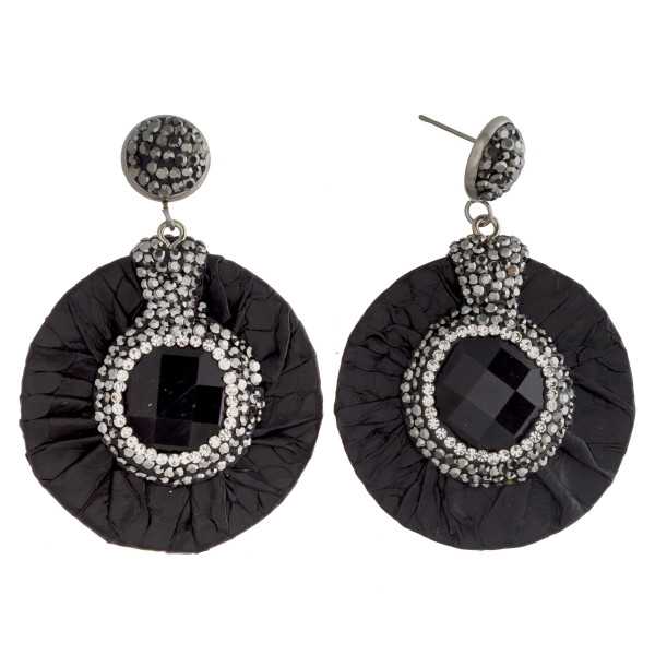 "Circular drop earrings featuring faux leather snakeskin, a druzy natural stone center detail with rhinestone accents. Approximately 1.5"" in diameter."