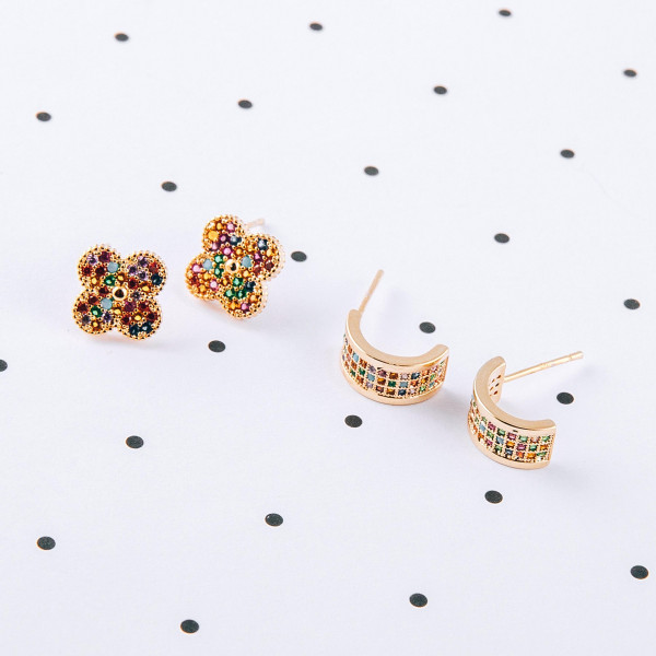 Dainty stud earrings featuring multicolor cubic zirconia details. Approximately 1cm in length.