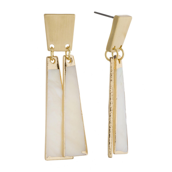 """Long brass ivory mother of pearl earrings. Approximately 2"""" in length."""