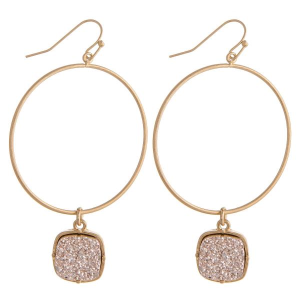 "Circular metal earrings featuring a druzy accent. Approximately 2.5"" in length."