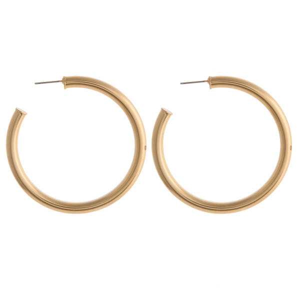 "Large open hoop metal earrings featuring a stud post. Approximately 2"" in diameter."