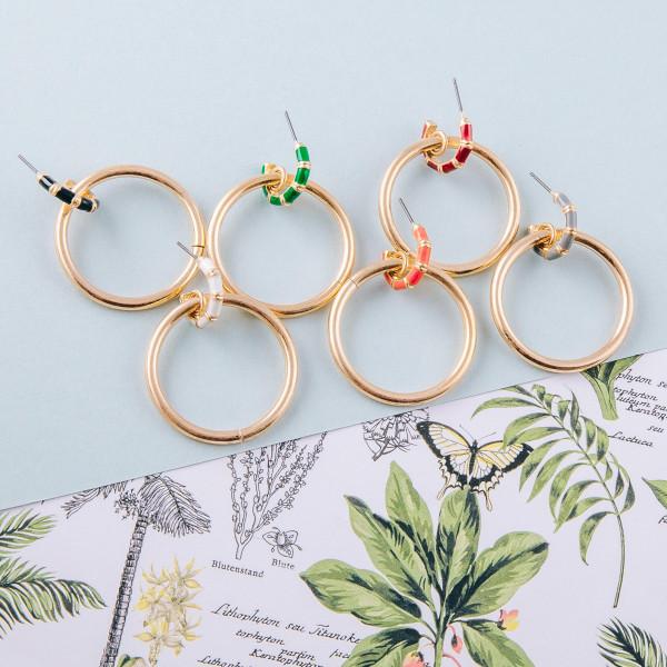 "Circular metal drop earrings featuring enamel stud details. Approximately 1.5"" in length."