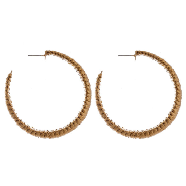 "Large raffia wrapped hoop earrings. Approximately 2.5"" in diameter."