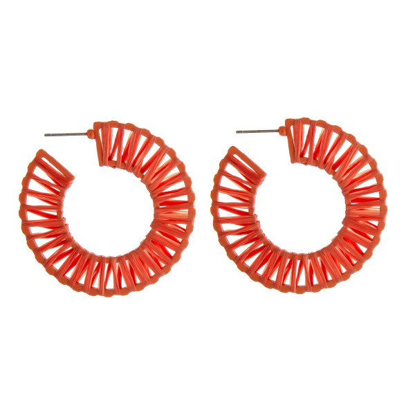 "Raffia wrapped hoop earrings. Approximately 2"" in diameter."