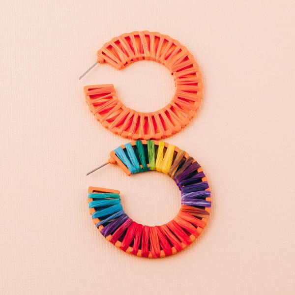 """Raffia wrapped hoop earrings. Approximately 2"""" in diameter."""