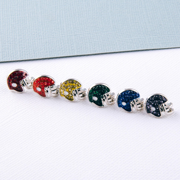 Football helmet stud earrings featuring cubic zirconia details. Approximately 1cm in diameter.