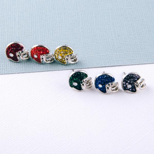 Football helmet stud earrings featuring cubic zirconia details. Approximately 1cm in diameter.