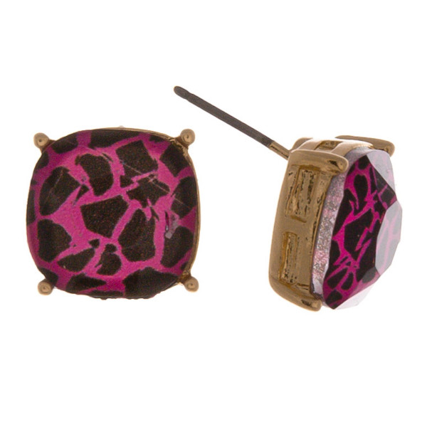 Stud earrings featuring a iridescent stone with animal print details. Approximately 1cm in diameter.