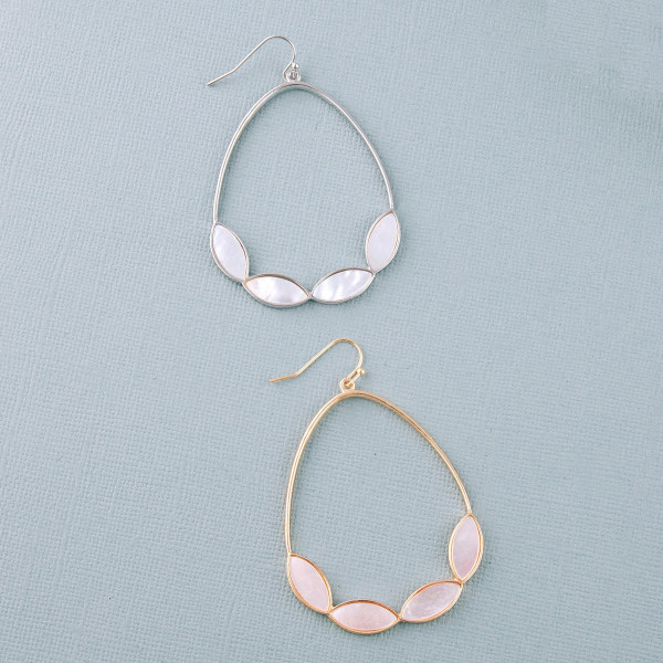 """Metal teardrop earrings featuring mother of pearl inspired accents. Approximately 2.5"""" in length."""