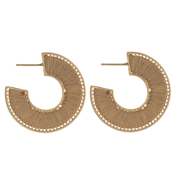 "Thread wrapped open hoop earrings featuring a stud post. Approximately 1"" in diameter."