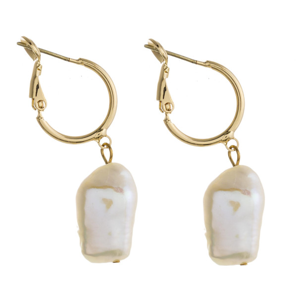 """Short hoop earrings featuring a pearl accent. Approximately 1.5"""" in length."""
