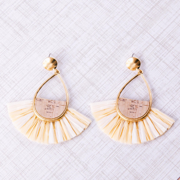 "Teardrop earrings featuring cork inspired details with raffia tassel accents. Approximately 3"" in length."