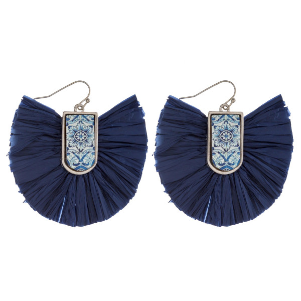 "Drop earrings featuring raffia tassel details with a wood inspired pattern accent. Approximately 2"" in length."