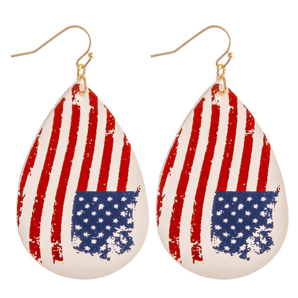 """Faux leather teardrop earrings featuring vintage, distressed American flag details. Approximately 3"""" in length."""