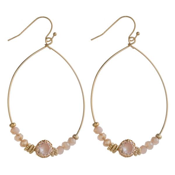 "Rhinestone accented beaded teardrop dangle earrings. Approximately 2.5"" in length."