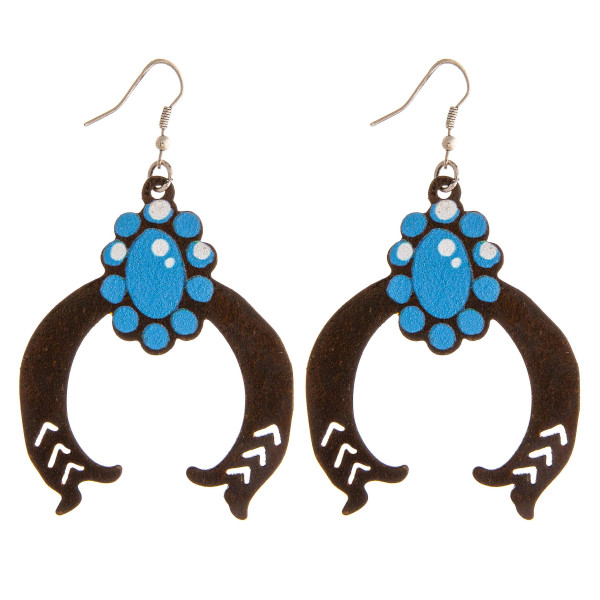 """Metal horseshoe earrings featuring a flower detail. Approximately 2.5"""" in length."""