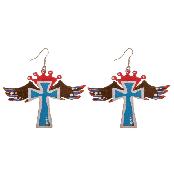"""Metal cross earrings featuring wings and crown details. Approximately 3"""" in length."""