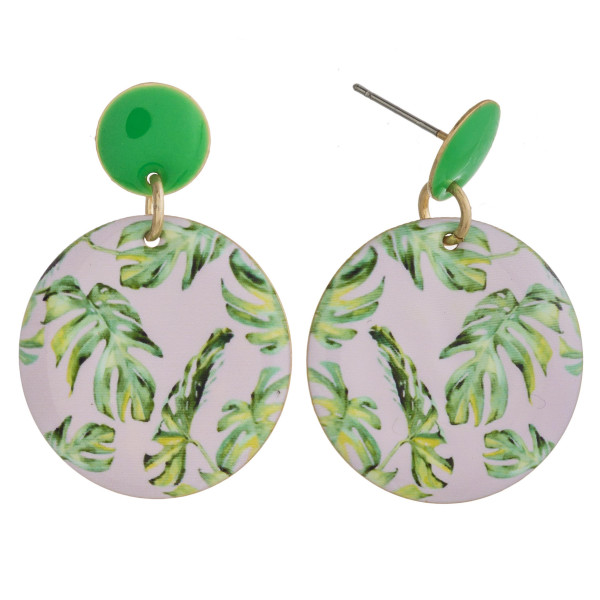 "Metal disc earrings featuring tropical palm leaf print enamel details. Approximately 1"" in length."