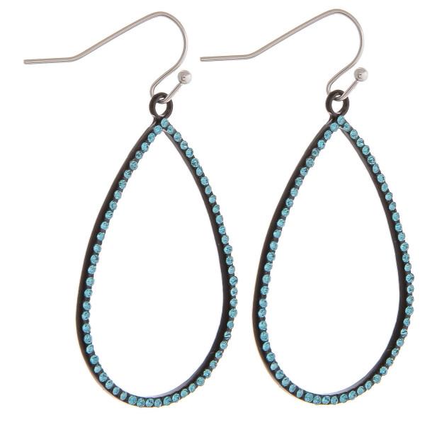 "Dainty teardrop earrings featuring cubic zirconia details. Approximately 2"" in length."