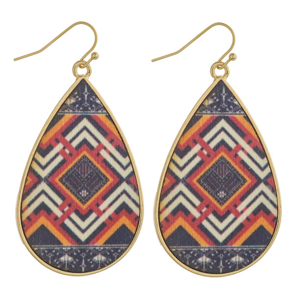"""Metal teardrop earrings with wood inspired tribal details. Approximately 2"""" in length."""