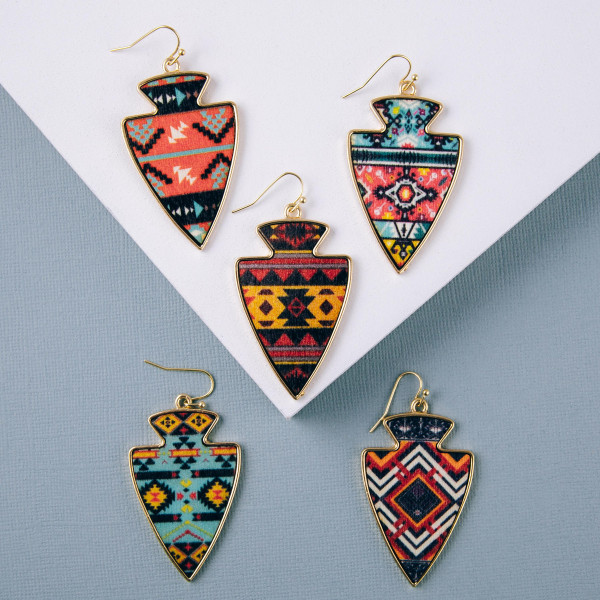 """Metal arrowhead earrings featuring wood inspired tribal details. Approximately 2"""" in length."""