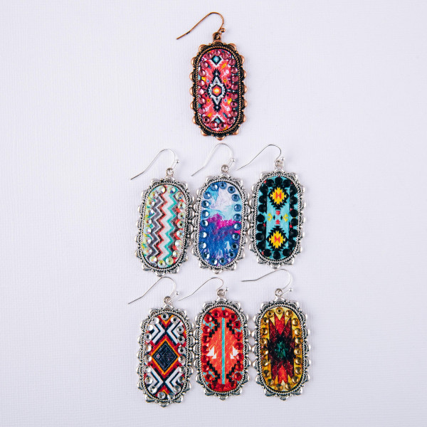 """Metal oblong earrings featuring faux leather tribal details with rhinestone accents. Approximately 2"""" in length."""