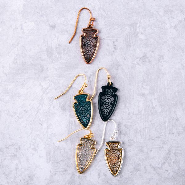 "Copper tone filigree inspired arrowhead earrings. Approximately 1"" in length."