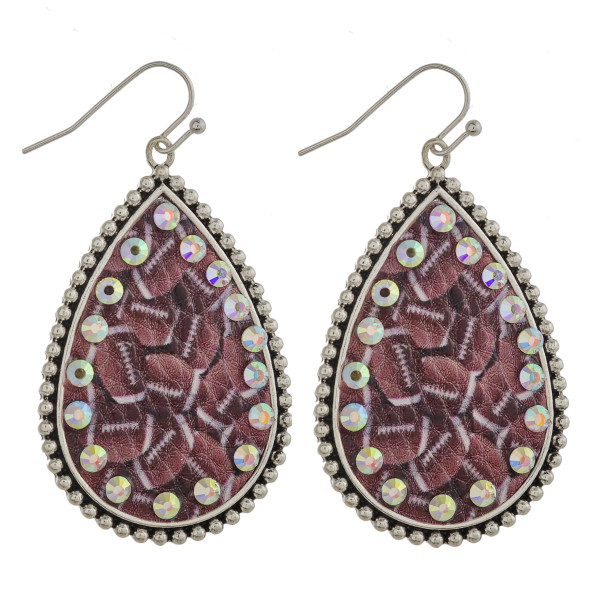 """Metal teardrop earrings featuring football faux leather details with rhinestone accents. Approximately 2"""" in length."""