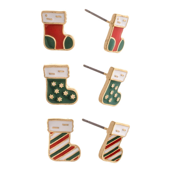 "Christmas stud earring set featuring three pairs with stocking enamel details. Approximately 1cm smallest size, .5"" biggest size."