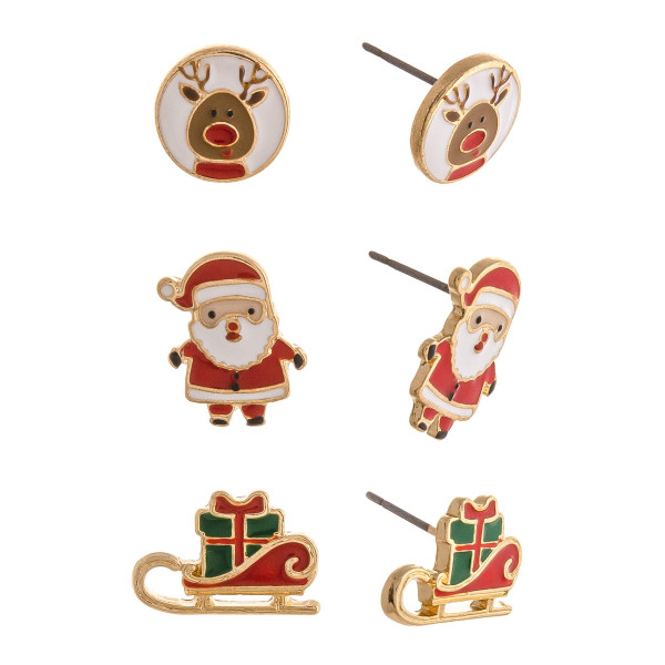 "Christmas stud earring set featuring three pair with Santa Claus, sleigh and reindeer enamel details. Approximately .5"" in size."