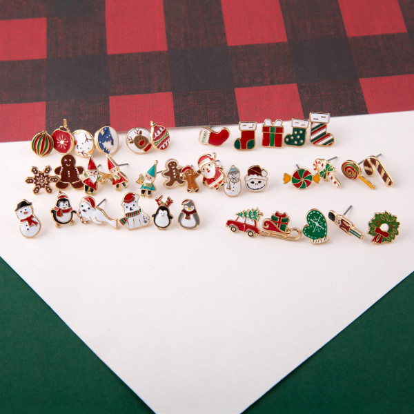 """Christmas stud earring set featuring three pairs with nutcracker, gingerbread and stocking enamel details. Approximately .5"""" in size."""