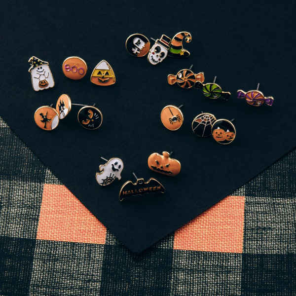 Halloween stud earring set featuring three pairs with pumpkin, spider and spiderweb enamel details. Approximately 1cm in size.
