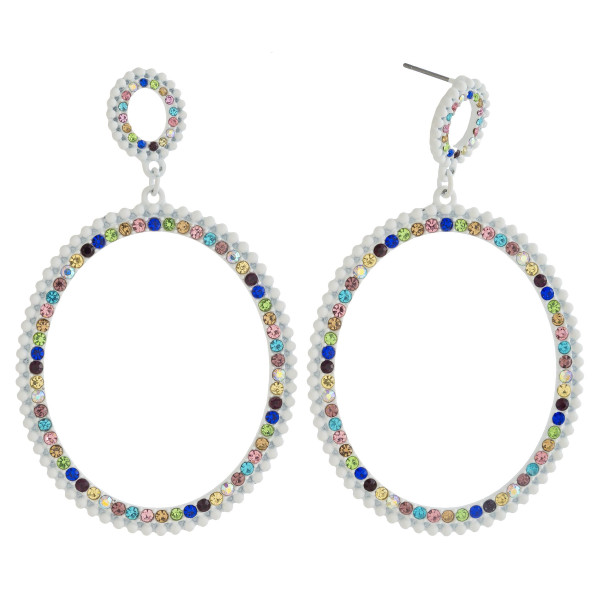 "Oval drop earrings featuring multicolor rhinestone accents. Approximately 3"" in length."