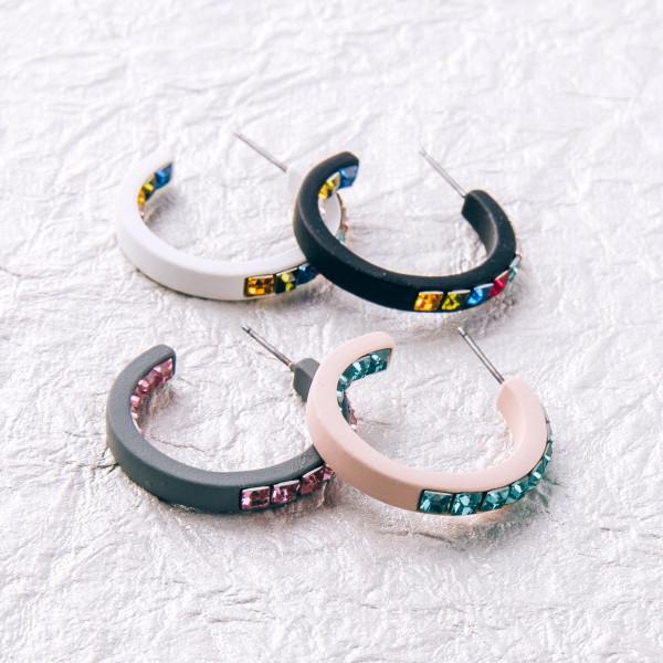 "Hoop earrings featuring double side multicolor rhinestone block details. Approximately 1"" in diameter."
