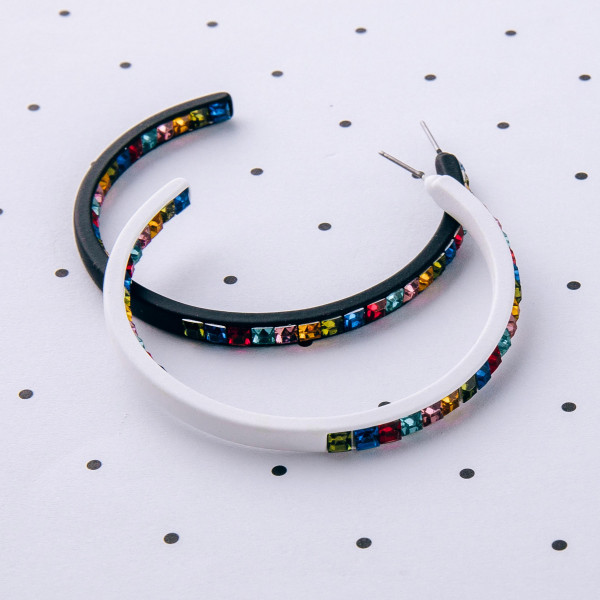 "Hoop earrings featuring double side rhinestone block details. Approximately 2"" in diameter."