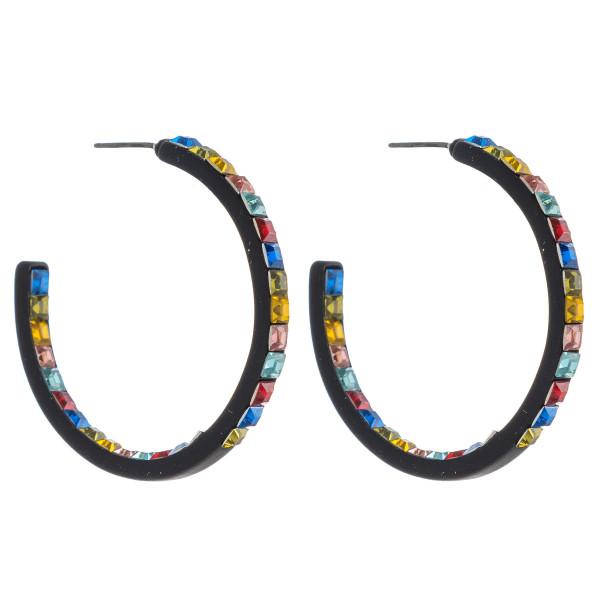 "Hoop earrings featuring double side rhinestone block details. Approximately 1.5"" in diameter."