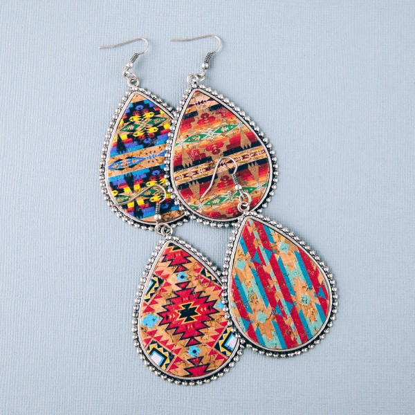 "Faux cork tribal print encased teardrop earrings.   - Approximately 3"" in length"