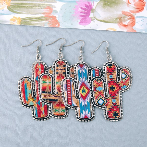"Faux cork tribal print encased western cactus earrings. Approximately 3"" in length."