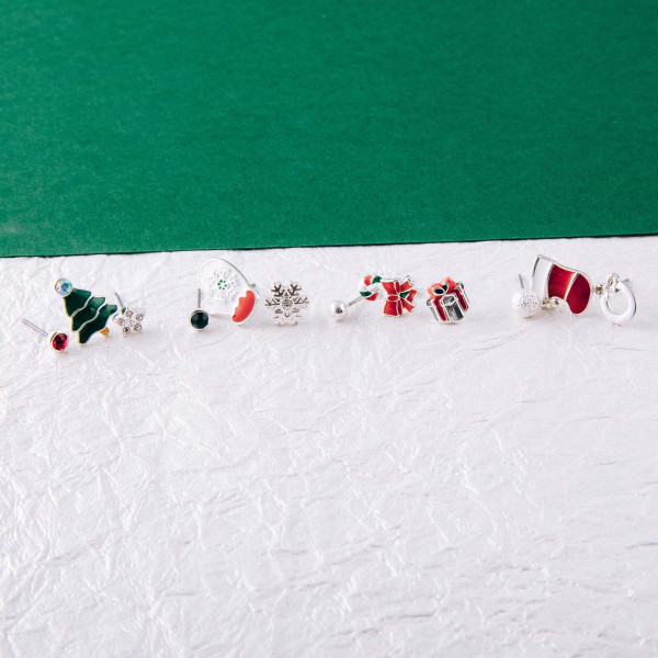 "Christmas assorted stud earring set featuring rhinestone and enamel details. Approximately .5cm in diameter to .5"" in length."