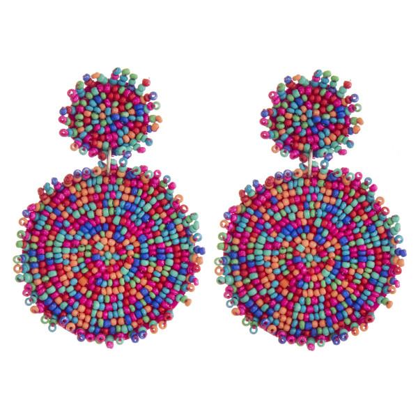 "Felt seed beaded disc dangle earrings. Approximately 3"" in length and 2"" in diameter."