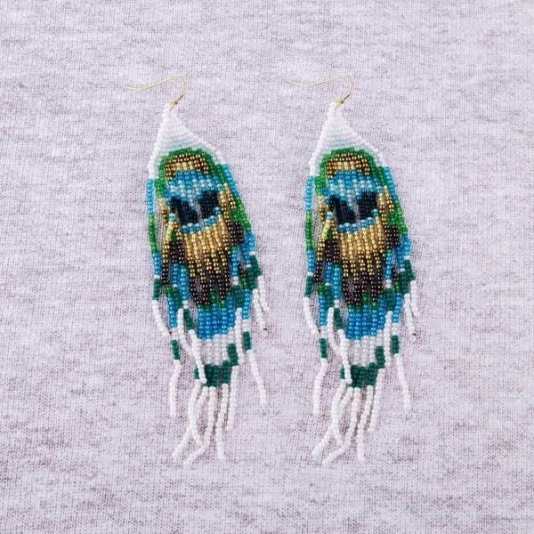 "Multicolor seed beaded boho tassel earrings. Approximately 4.75"" in length."