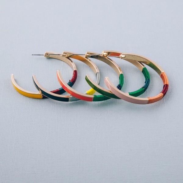 "Enamel coated thread wrapped hoop earrings. Approximately 2"" diameter."