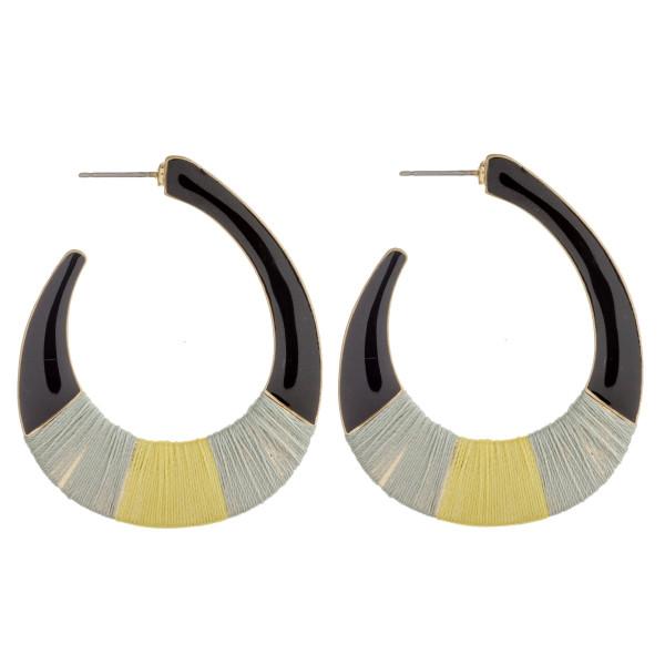 "Enamel coated thread wrapped wide J hoop earrings. Approximately 2"" in length."