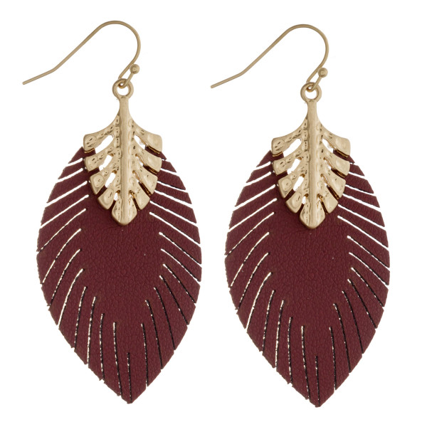 "Faux leather leaf dangle earrings. Approximately 2.25"" in length."