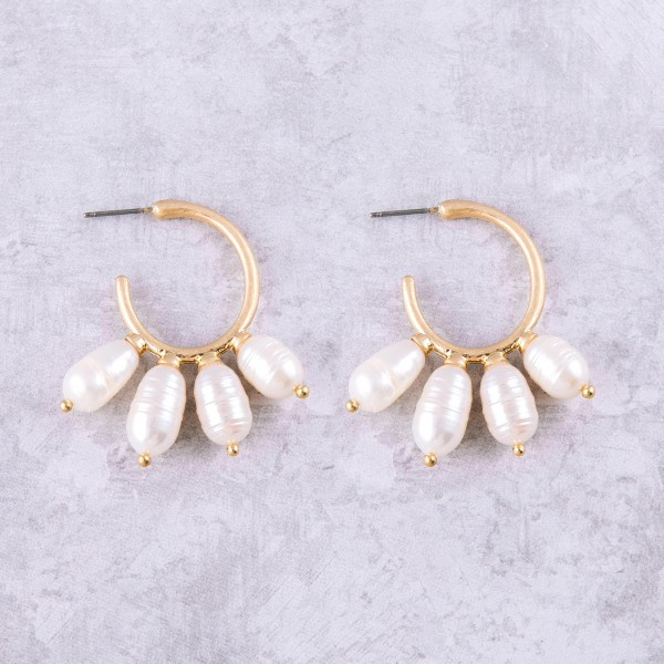 "Faux pearl metal open hoop earrings. Approximately 1.5"" in length."