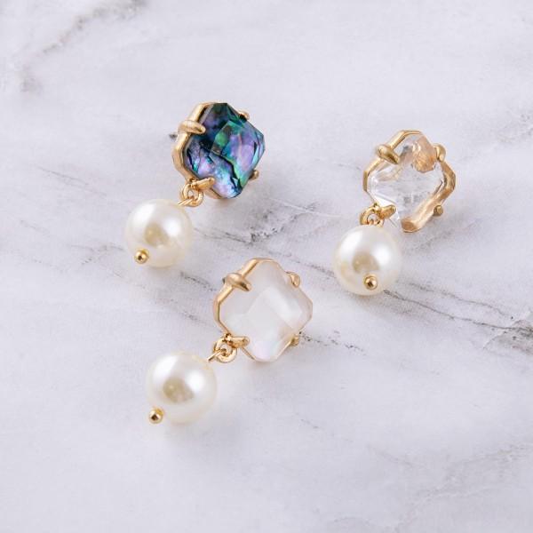 "Rhinestone encased pearl drop earrings. Approximately 1"" in length."